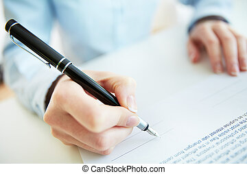 About to sign - Close-up image of a business woman being to...