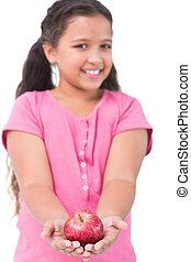 Little girl holding apple in her hands