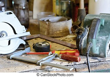 Tools on the workbench, screwdriver, meter and grinder