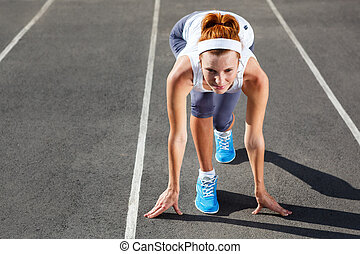 Woman getting ready to start on Stadium. - Woman getting...
