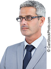 Thoughtful businessman wearing glasses on white background