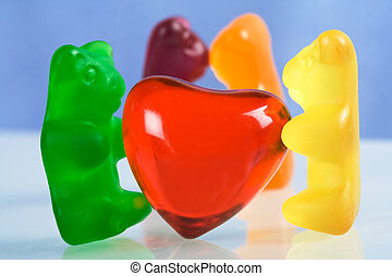 Gummy bear candy and red heart - Gummy bear candies with red...
