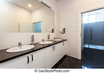 Public bathroom and toilet, three washbasins