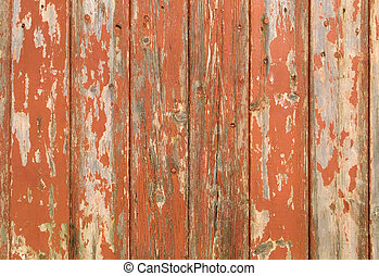 Orange flaky paint on a w
