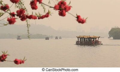 Boat Float Lake Blossoming Cherry - Boats float on the lake....