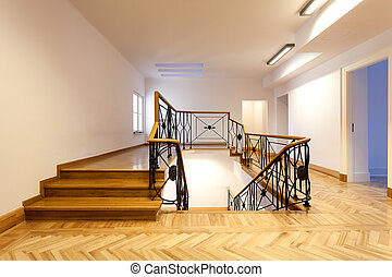 Elegant staircase inside of a classic hall