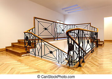 Stairs - Wooden stairs with balcony and decorative metal...