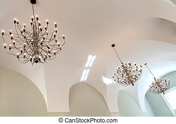 Chandeliers - Elegant chandeliers and a white classic...