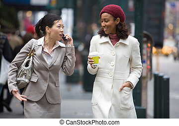City Business Women - Two business women walking in the big...