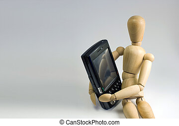 Cellular Communication - Wooden dummy grasping a mobile...