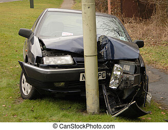 Car crash - image of a car that has crashed into a post at...