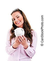 Business woman saving money in a piggybank - isolated over a...