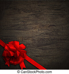 Red bow on black wall wood texture background