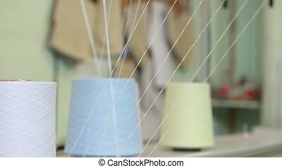 Weaving loom works - view of bobbins, close-up