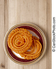 indian jalebi sweets - close up of indian jalebi sweets