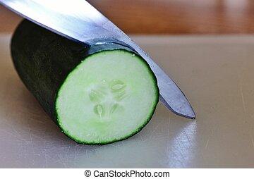 Cut the cucumber - Knife slicing through a cucumber