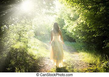 Walking fairy - Beautiful young woman wearing elegant white...