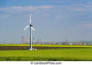Sustainable energy - Wind turbine in a field of wheat and...