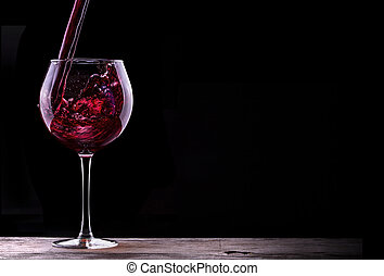 Elegant red wine glass in black background - Elegant red...