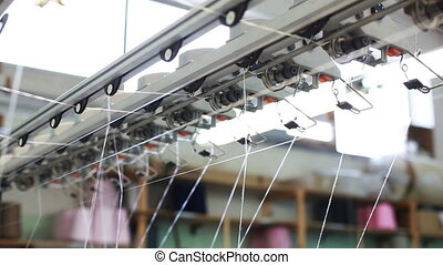 View of moving threads on loom, close-up