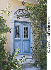 Antique blue door in Simi - Antique blue door surrounded of...