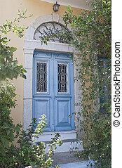 Antique blue door in Simi - Antique blue door surrounded of...