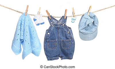 All Boy Clothing Hanging on a Clothesline Isolated on White...