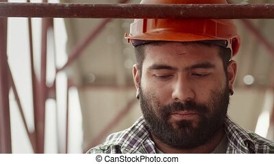 2of11 Man job, construction worker - Young hispanic man at...