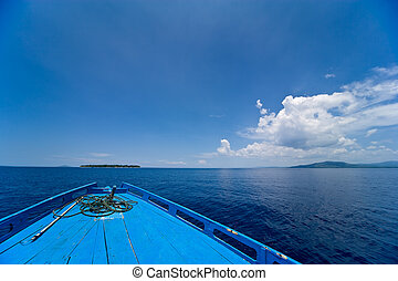 Dive boat. - View of a diving boats bow against a blue sky...
