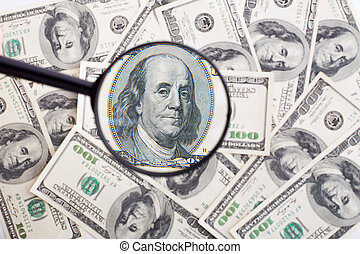 Dollars and black magnifying glass - Background made of...