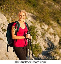 Woman on trekking - Beautiful blonde girl hiking on...