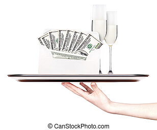 money in envelope on a tray with champagne and hand - money...