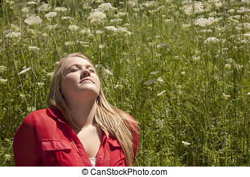 Teen Girl with Head Back Sun Bathing - A teenager sitting...