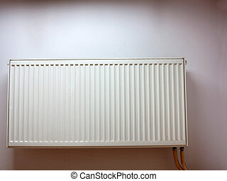 modern radiator at the wall - central heating radiator...