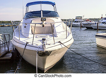 Docked Cabin Cruiser - Beautiful white cabin cruiser bow...