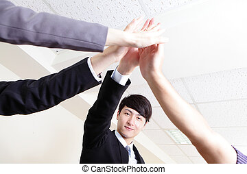 Successful business people group celebrating with hands...