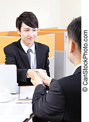 Portrait of successful businessman at the interview at...