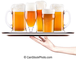 beer on a silver tray with waitress hand - Frosty fresh beer...