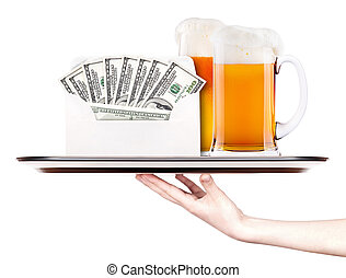 money in envelope on a tray with beer and hand - money in...