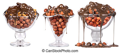Chocolate Flowing over nuts in a glass Isolated on White -...