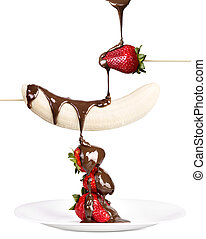strawberries and banana with chocolate isolated on a white...