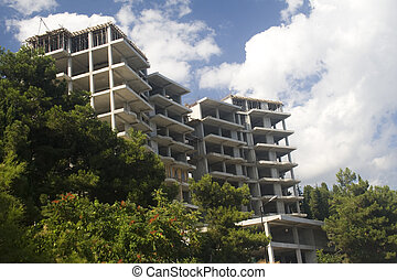 Construction - Multilevel new cement building on hill in...