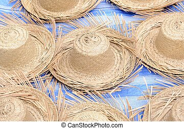 Straw hat in local market.