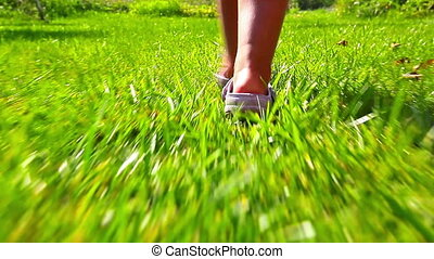 girl running on green grass