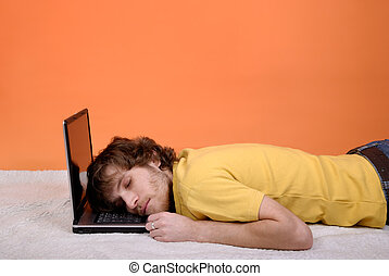 A man sleeping on the laptop