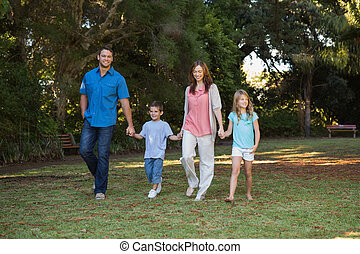 Parents walking with their two children