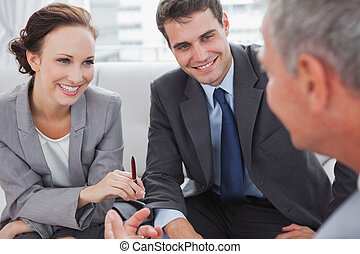 Partners having a meeting in cosy meeting room