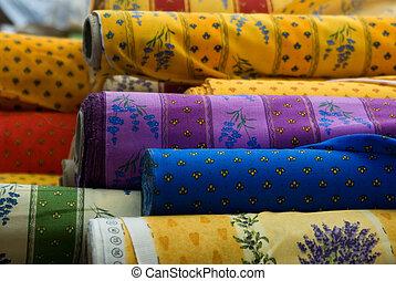 Fabrics rolls - Rolls of fabrics sold in an outdoor market