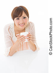woman who takes a drink - young attractive asian woman who...