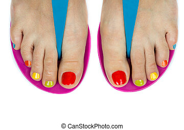 Beautiful female feet with a pedicure color